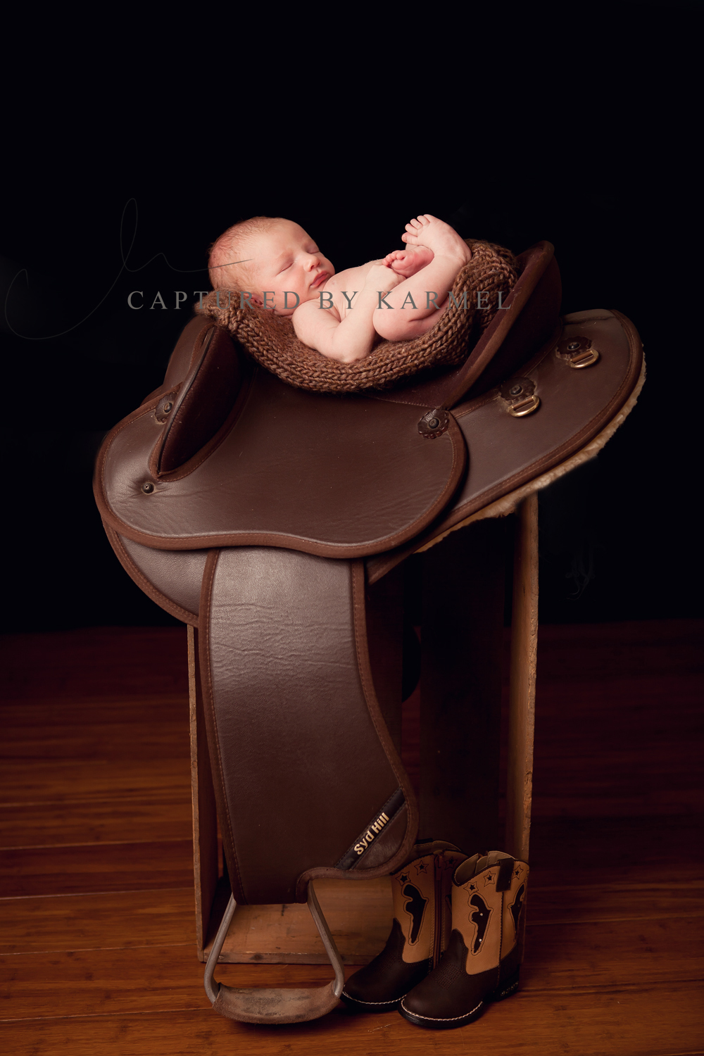 newborn baby on saddle