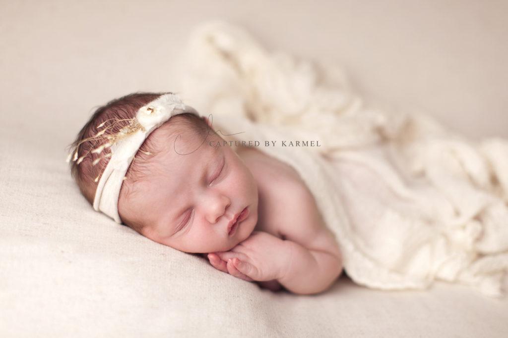 newborn girl photo on white blanket