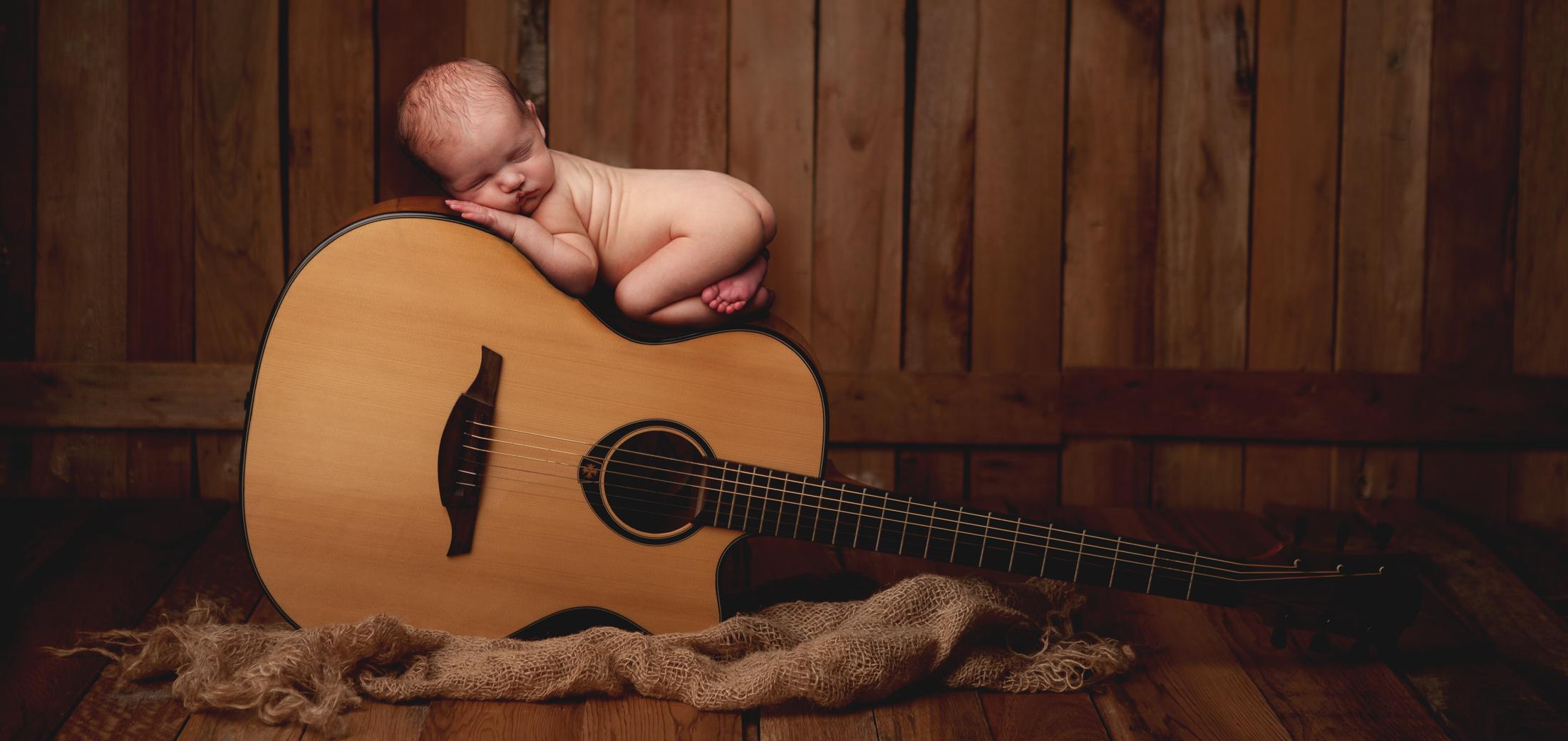 newborn on guitar photo