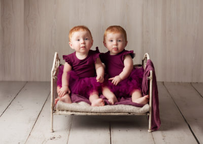 baby twins in vintage cot